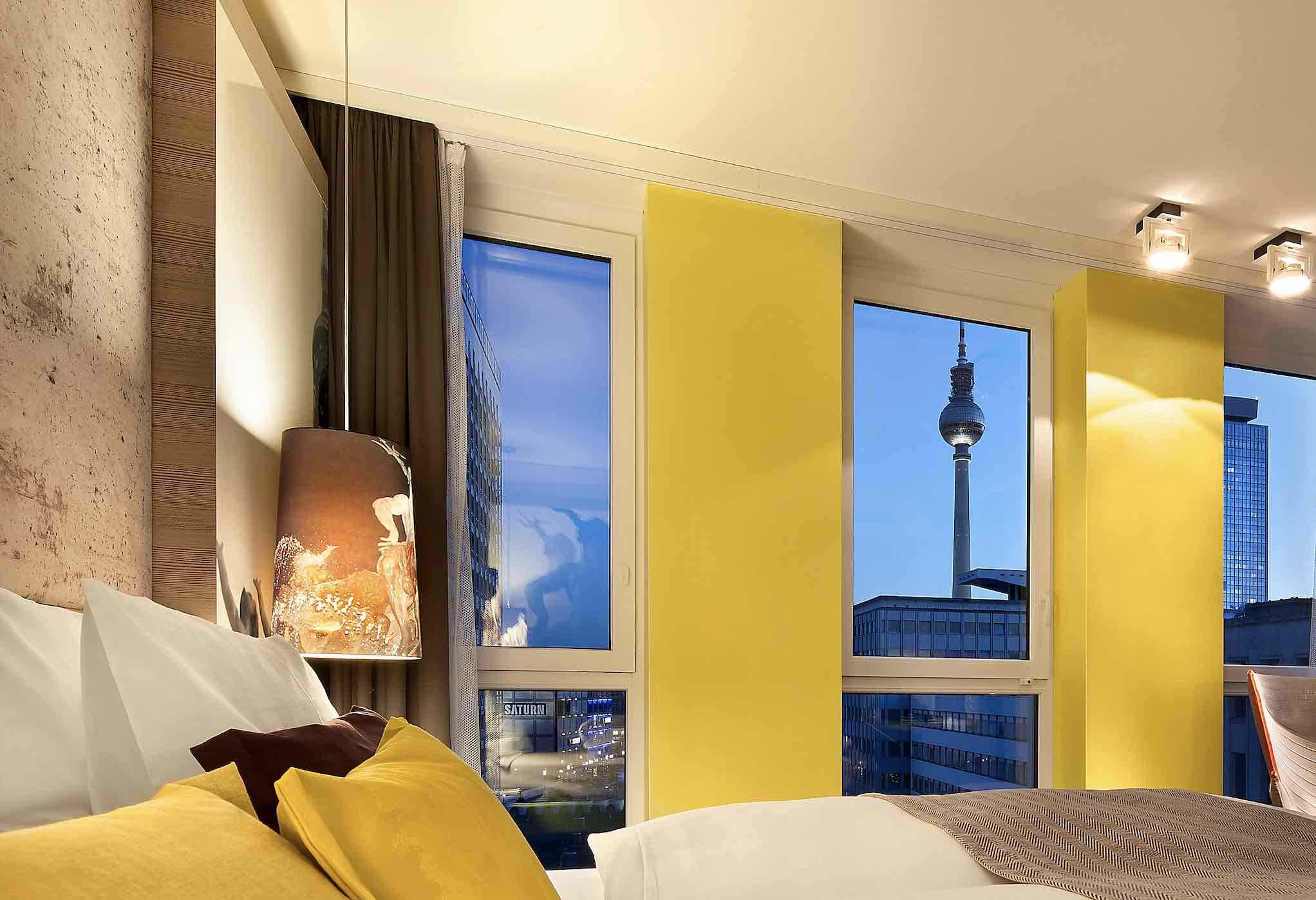 Hotel Indigo Berlin - Centre Alexanderplatz is one of the best boutique hotels in Berlin with bedroom view with Berlin Tower