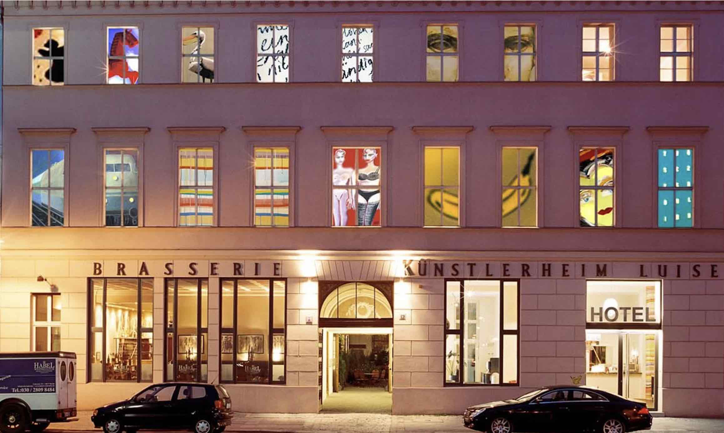 Arte Luise Arthotel unique hotels in berlin exterior at night with painted windows