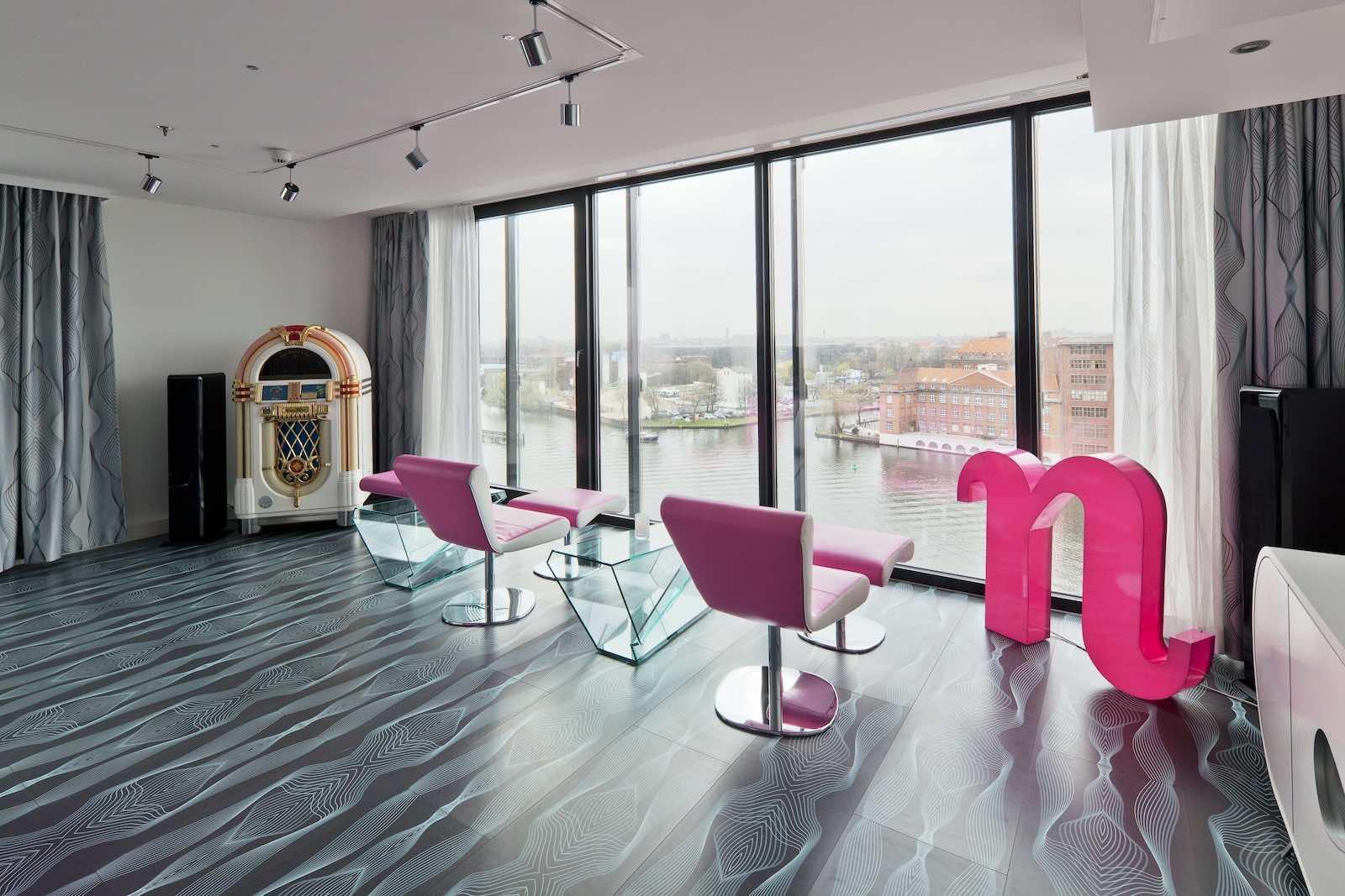 nhow_berlin- pink chairs juke box and river views